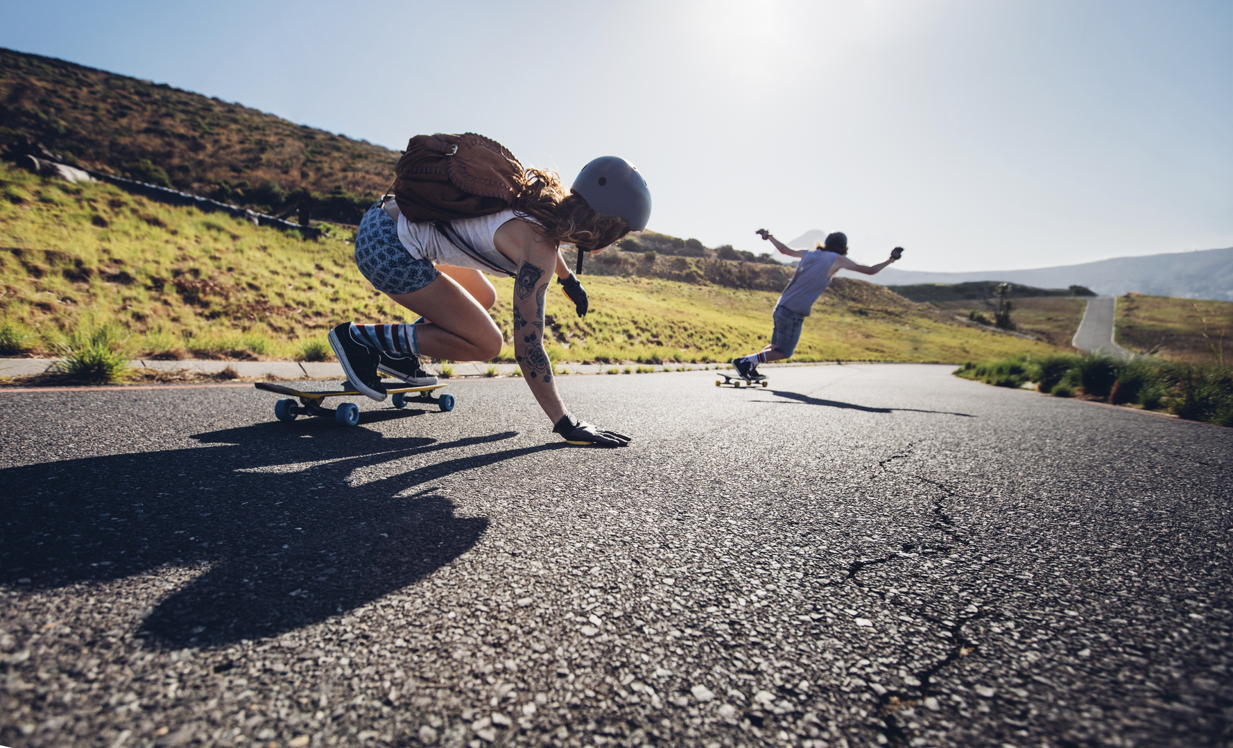 Young people skateboarding outdoors on the road