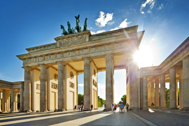 """Brandenburg GateBerlin, Germanysome lens flare, people in motion blur"""