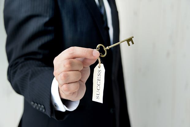 Businessman having key to success
