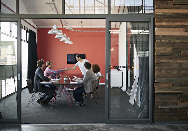 Shot of a group of colleagues having a meeting in a boardroom