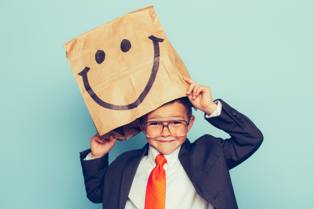 Young Boy Businessman Wears Happy Face