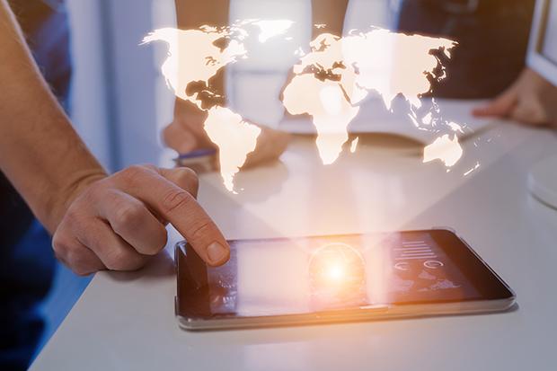 Global business concept, world map hologram, business team